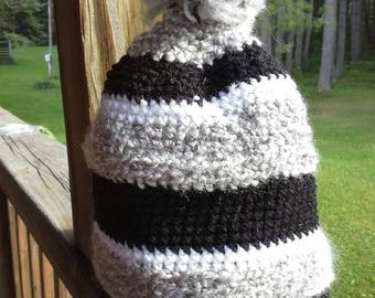 Striped crocheted hat with handmade pompom
