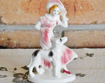 Unmarked porcelain figurine windswept girl with dog, vintage 1940s, Gift idea