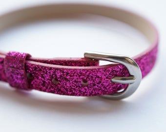 fuchsia glitter leather bracelet.