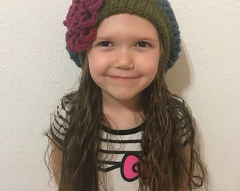 Crocheted slouchy beanie with flower