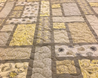 A queen size gray and yellow quilt