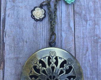 Bronze pendant necklace with rose charms