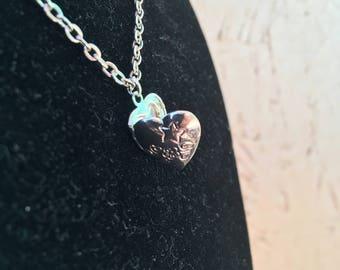 Tiny silver heart shaped locket choker necklace.