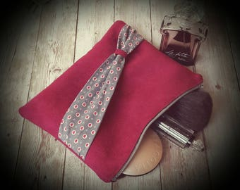 Pouch bag, make-up bag or paper.