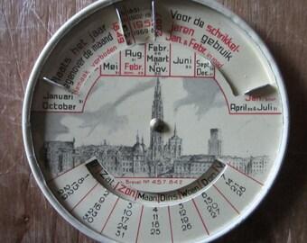 tin toy perpetual calendar Antwerp Belgium skyline 1949