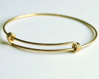 GOLD Stainless steel vacuum plated TRIPLE LOOP expandable bangle bracelet. Beautifully tarnish resistant, superior plating. Charm bracelets