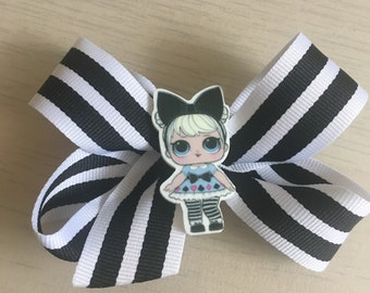 Grosgrain ribbon bow with doll embellishment