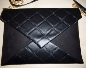 Over sized black quilted faux leather and suede clutch bag with detachable strap