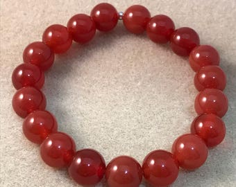 Carnelian Deep Sienna Red 10mm Round Stretch Bead Bracelet with Sterling Silver Accent