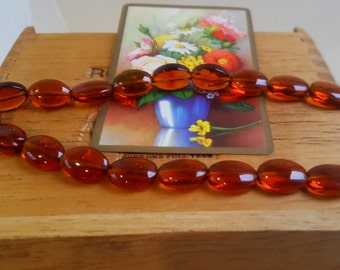 """24 Amber Colored """"puffed"""" Oval Beads, Clear Glass Beads, 15mm x 6mm"""