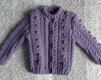 Purple girl 1 year vest balls, dimples, and hand knitted cable