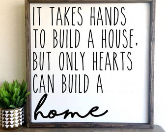 It takes hands to build a house, but only hearts can build a home   framed wood sign