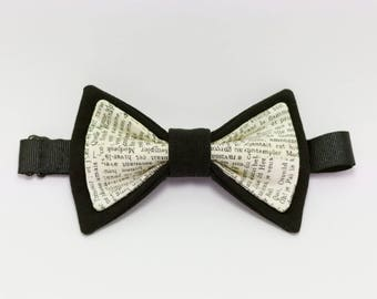 Black and white bowtie with printed text