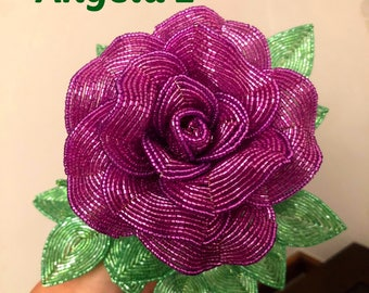French Beaded Rose with two buds .