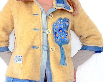 Recycled jacket of artifical hair pie on jeans.By hand paint bloom.
