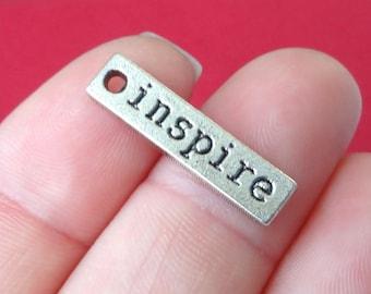 "10 ""inspire"" Charms 5.5x23x1.5mm ITEM:Q23"
