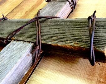 Reclaimed barn wood and barbwire cross