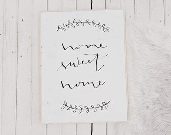 home sweet home black and white wooden sign