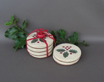 Stoneware coasters with imprinted holly leaves and berries
