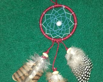 Dream catcher with exotic bird feathers.