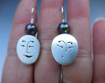 Unmentionables earrings with oval face