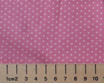 High quality cotton poplin, white polka dots on mid pink