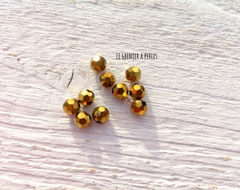 Faceted 6 mm round beads Bronze X 10