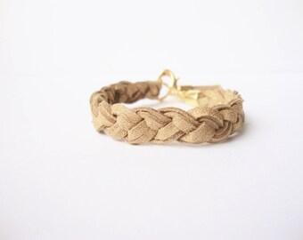 Bohemian braided bracelet in Orange glitter gold with tassel