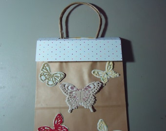 Gift Bag decorated on both sides. removeable topper and gift tag. 2.00 discount if purchasing 5 or more