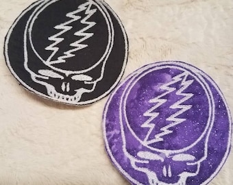 Steal Your Face, Grateful Dead patch, Glow in the Dark, skull embroidered accessory, sparkling purple background