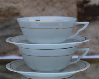 Pair of beautiful French Vintage Limoges tea or coffee cups and saucers. Fine white porcelain with gold leaf trim. French Vintage Chic