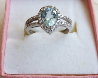 Vintage ring with blue topaz in silver