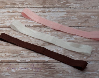 One (1) Soft Elastic Headband . Choice of Multiple Colors