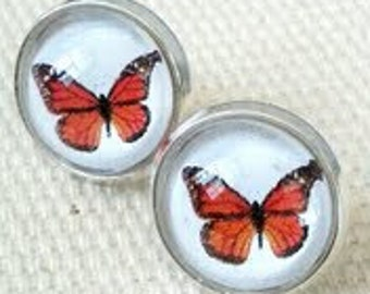 Butterfly Stud Earrings. Hand made in Brooklyn. Delicate Orange butterflies under crystal clear glass domes.