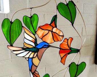 Tiffany stained glass suncatcher of a hummingbird hovering and drinking from a flower, window hanger made in colored glass with amazing vibe