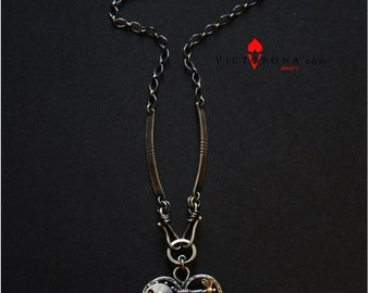 """Kinetic necklace """"Enigma"""". Heart shaped. Interactive with a spin."""