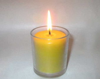Natural beeswax in right glass candle.