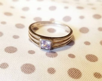 Handmade sterling silver ring with square light purple stone