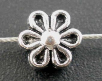10 spacer beads in silver, 6 petal flower pattern