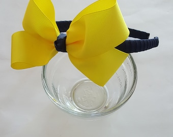 Navy blue headband with large yellow bow University of Michigan colors