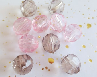 set of 11 beads has faceted plastic
