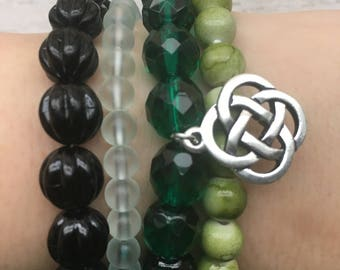 4 Stackable Beaded Bracelets: Czech Glass Emerald Green, Grass Green, Sea-foam Green, Black With a Celtic Knot Charm