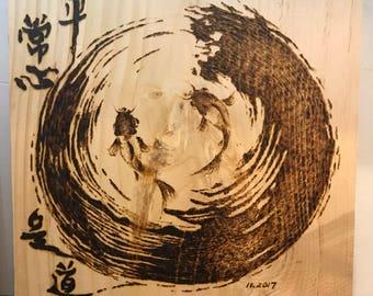 Wood burning Zen ad fish
