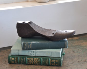 Solid iron antique shoe form - great as an industrial look paperweight