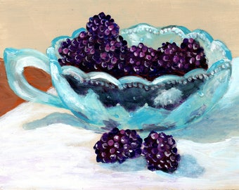 blue etched glass dish filled with blackberries still life