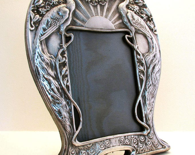 Featured listing image: Magnificent SOLID BRITANNIA SILVER .958 Art Nouveau Style Picture Photo Frame. (Peacock, rising sun, flowers)