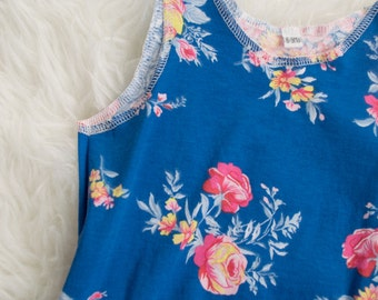 6-9 month pink yellow and light blue floral on blue pull on summer romper. Ready to ship. Little Lapsi