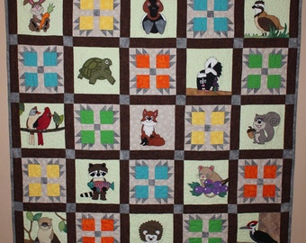 Woodland or forest animal applique PDF quilt pattern; bear's paw block; fox, raccoon, or squirrel quilt; baby or child's quilt pattern