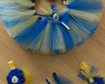 Custom Team Tutu's Sets your choice of tutu with a matching headband.   Featuring West Virginia Mountaineers