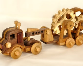 Wood toy tractor and trailer with moving geats